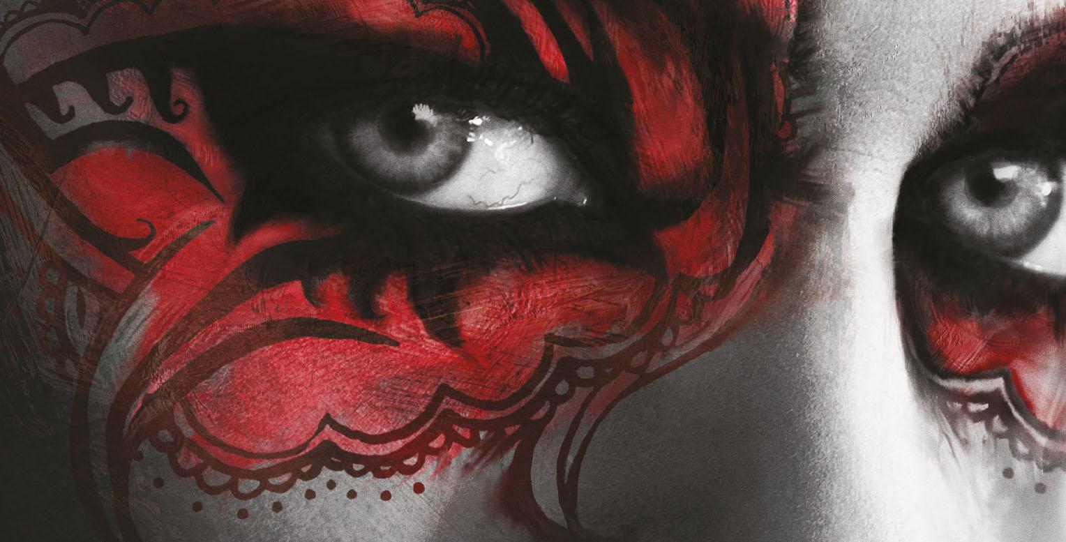 Två ögon med rött smink tittar rakt ut från bilden.