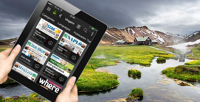 Till vänster: iPad med appen PressReader. Bakgrund: Landskap i Landmannalaugar, Iceland.